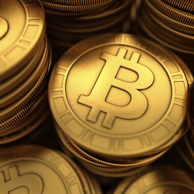 Close up 3D illustration of paneled golden Bitcoins